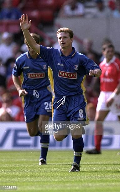 Mark Robins of Walsall celebrates his goal against Nottingham Forest in the Nationwide Division One match at the City Ground in Nottingham England...