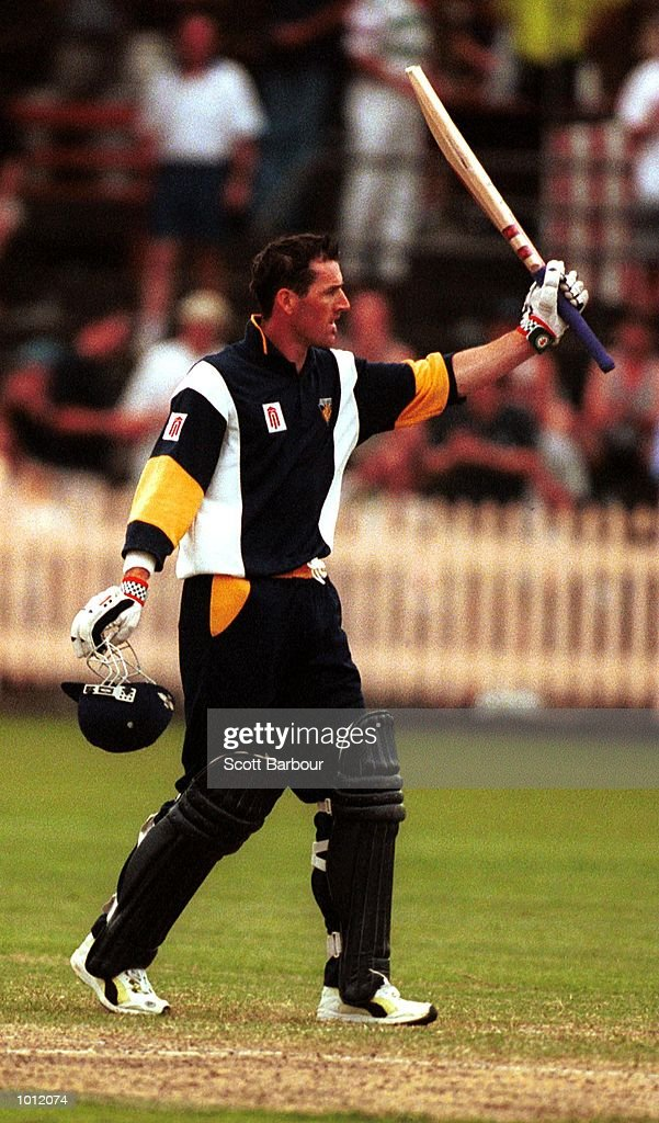 Matthew Elliott of the Victorian Bushrangers celebrates his century against the NSW Blues during the Mercantile Cup Cricket at the North Sydney Oval, Sydney, Australia. Mandatory Credit: Scott Barbour/ALLSPORT