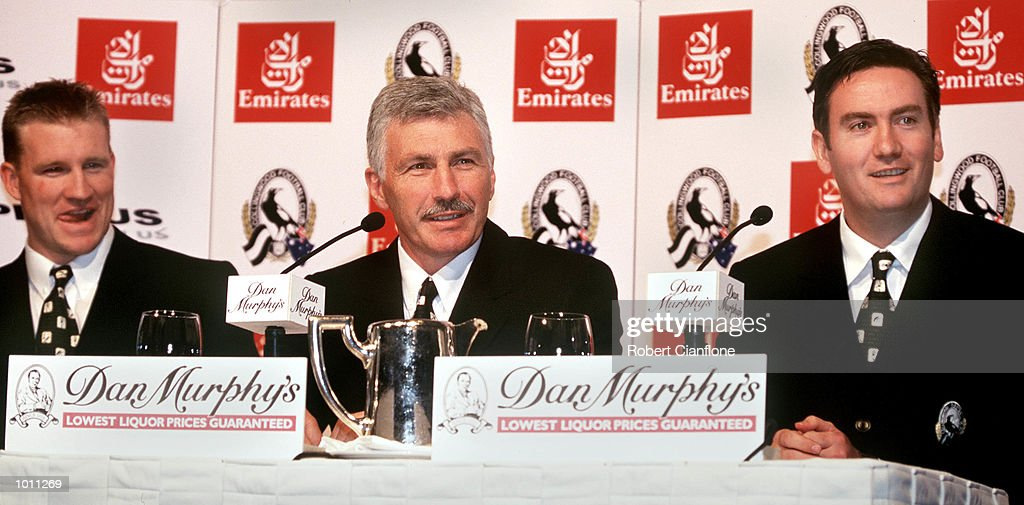 Michael Malthouse (centre) sits in the middle of captain Nathan Buckley (left) and club President Eddie McGuire (right) at the at the Grand Hyatt in Melbourne, Australia. Here, it was announced by the Collingwood Football Club, that Malthouse would be the new coach of the club for the next three years. Mandatory Credit: Robert Cianflone/ALLSPORT