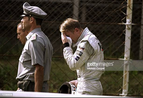Mika Hakkinen of Finland and McLaren Mercedes is distraught after spinning off the circuit whilst leading on the 29th lap of the Italian Formula One...