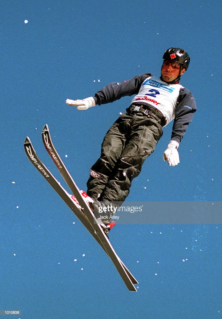 Nicolas Fontaine of Canada flies above the Mount Buller world cup aerials site during the first round of the 1999/2000 world cup aerials season, at Mount Buller, Australia. Fontaine, who is a three time world cup champion and reigning world cup champion finished sixth in the mens section. Mandatory Credit: Jack Atley/ALLSPORT