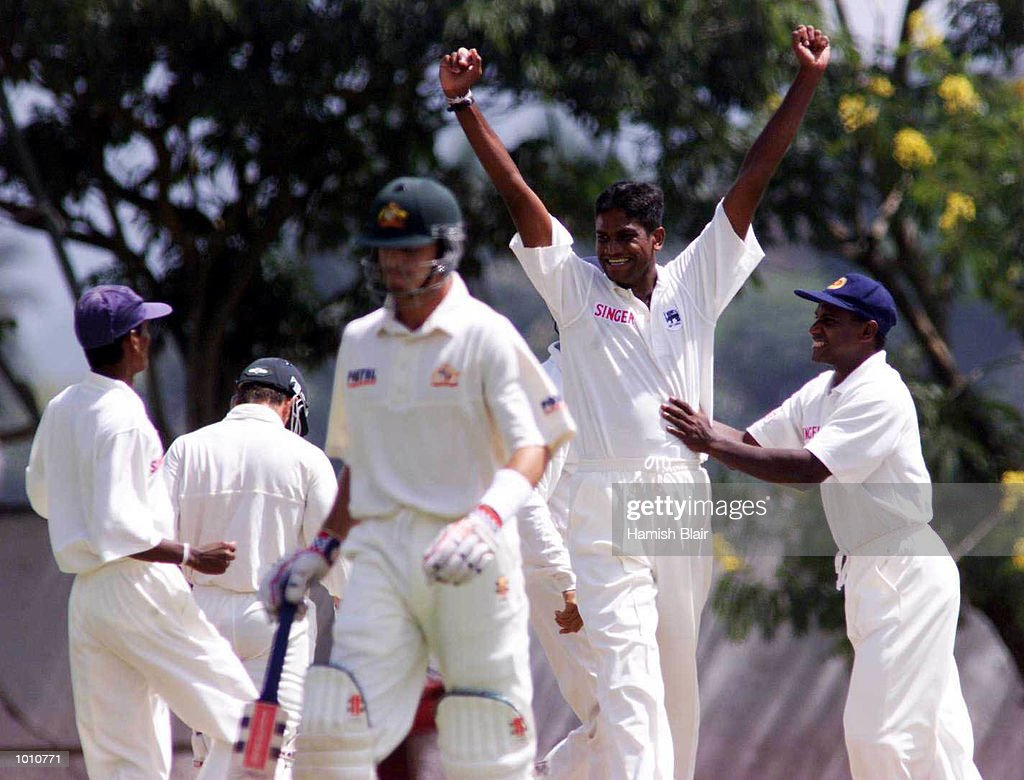Nuwan Zoysa of Sri Lanka celebrates after trapping Greg Blewett (foreground) of Australia LBW for a duck, during day one of the First Test between Sri Lanka and Australia at Asgiriya Stadium, Kandy, Sri Lanka. Mandatory Credit: Hamish Blair/ALLSPORT