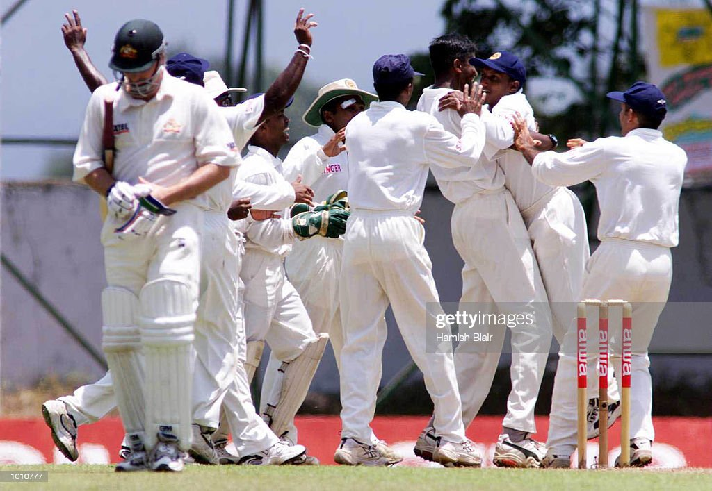 Nuwan Zoysa of Sri Lanka celebrates with team mates after dismissing Steve Waugh (foreground) of Australia, during day one of the First Test between Sri Lanka and Australia at Asgiriya Stadium, Kandy, Sri Lanka. Mandatory Credit: Hamish Blair/ALLSPORT
