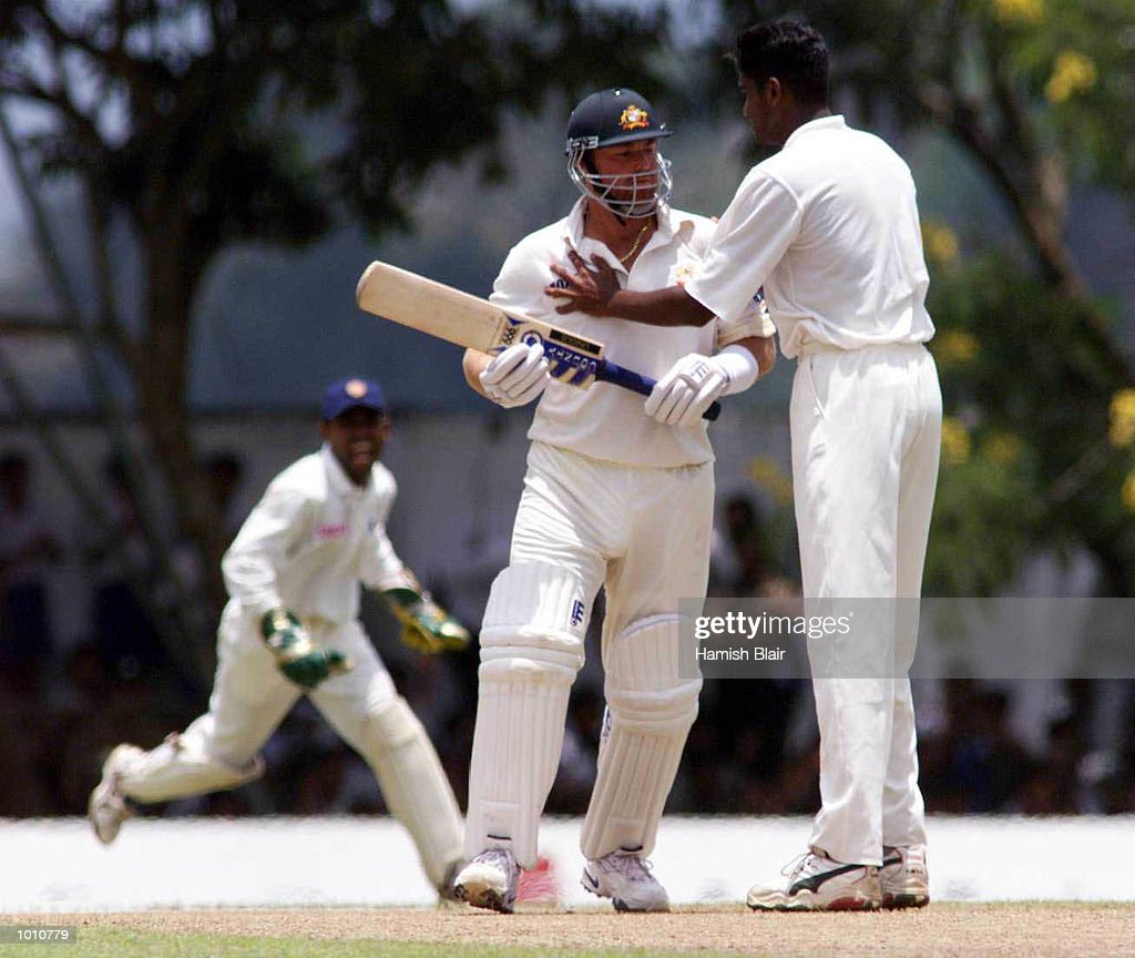 Nuwan Zoysa of Sri Lanka clashes with Shane Warne of Australia after Zoysa had dismissed Warne, Romesh Kaluwitharana celebrates the wicket in background, during day one of the First Test between Sri Lanka and Australia at Asgiriya Stadium, Kandy, Sri Lanka. Mandatory Credit: Hamish Blair/ALLSPORT