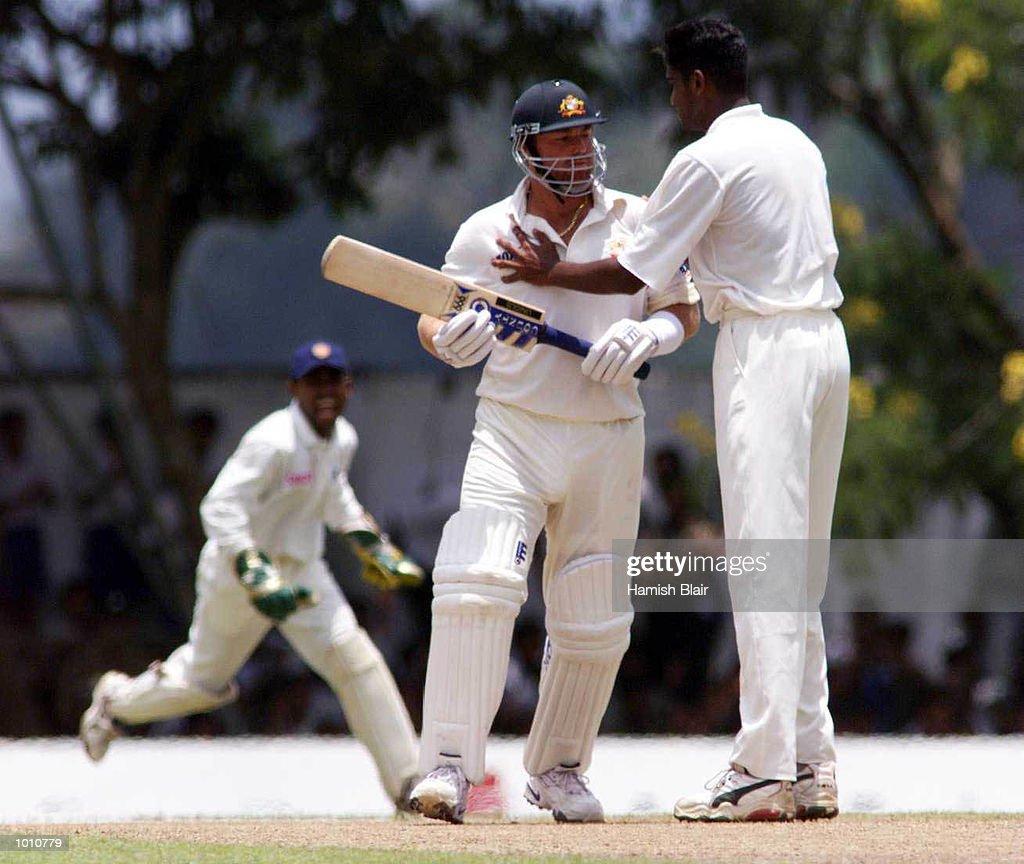 Nuwan Zoysa of Sri Lanka clashes with Shane Warne of Australia after Zoysa had dismissed Warne, Romesh Kaluwitharana celebrates the wicket in background, during day one of the First Test between Sri Lanka and Australia at Asgiriya Stadium, Kandy, Sri Lanka. Mandatory Credit: Hamish Blair/ALLSPORT