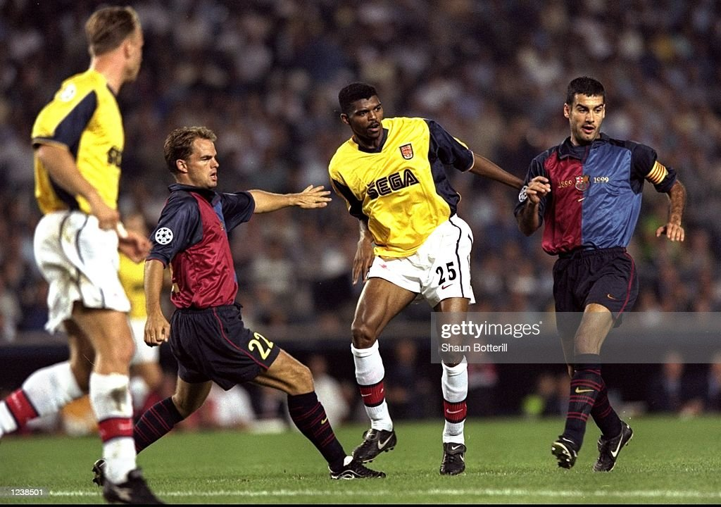 Nwankwo Kanu of Arsenal is closed down by Frank de Boer and Josep Guardiola of Barcelona during the Barcelona v Arsenal UEFA Champions League Group B match played at the Nou Camp, Barcelona, Spain. The game finished in a 1-1 draw. \ Mandatory Credit: Shaun Botterill /Allsport