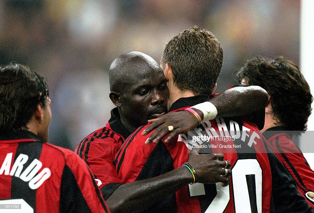 Oliver Bierhoff of Milan is congratulated by team mates during the Serie A match between AC Milan and Bologna played at the San Siro, Milan, Italy. Tha game finished in a 4-0 victory for Milan. \ Mandatory Credit: Claudio Villa /Allsport