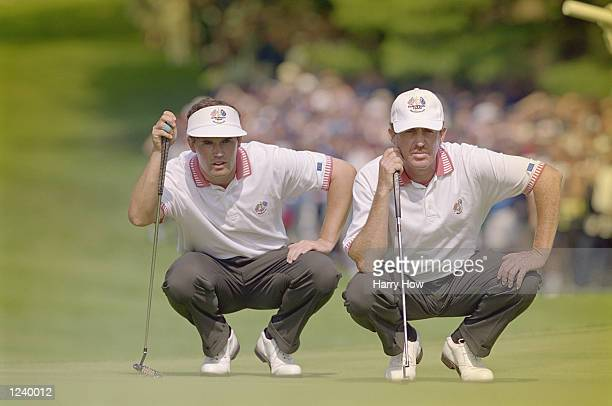 Padriag Harrington of Ireland and Miguel Angel Jimenez of Spain and Europe looks despondent during the 33rd Ryder Cup played at Brookline CC in...
