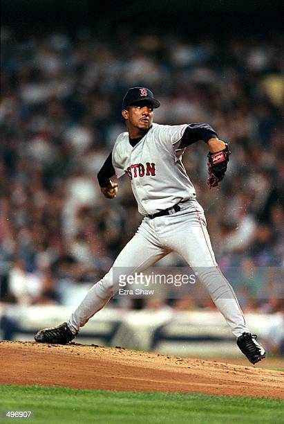 Pedro Martinez of the Boston Red Sox winds bak to pitch the ball during a game against the New York Yankees at the Yankee Stadium in Bronc, New York....