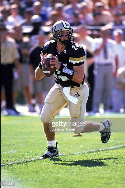 Quarterback Drew Brees of the Purdue Boilermakers moves back to pass the ball during the game against the Notre Dame Fighting Irish at the Ross-Ade...