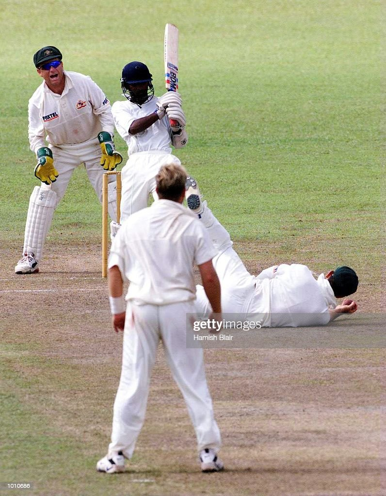Ricky Ponting of Australia dives for a miraculous catch off Chamara Silva but it was given not out, as Shane Warne and Ian Healy look on, during day three of the tour match between the Sri Lanka Board XI and Australia at Saravanamuttu Stadium, Colombo, Sri Lanka. Mandatory Credit: Hamish Blair/ALLSPORT