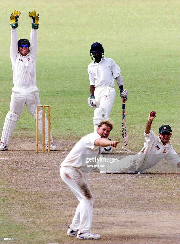 Ricky Ponting of Australia dives for a miraculous catch off Chamara Silva but it was given not out, as Shane Warne and Ian Healy also appeal, during day three of the tour match between the Sri Lanka Board XI and Australia at Saravanamuttu Stadium, Colombo, Sri Lanka. Mandatory Credit: Hamish Blair/ALLSPORT