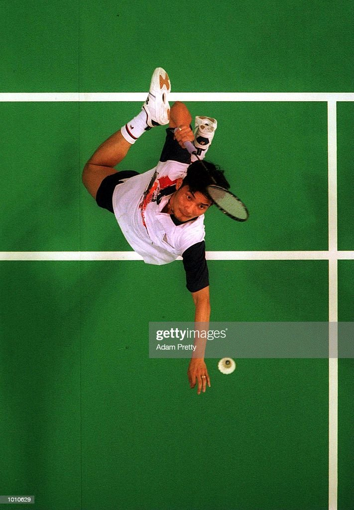 Rio Sgryania of Australia hits a smash on his way to defeating Betrand Gallett in the mens singles semi-final at the Australian Badminton International, a SOCOG Olympic test event, Pavilion 4, Olympic Park, Homebush, Sydney, Australia. Mandatory Credit: Adam Pretty/ALLSPORT