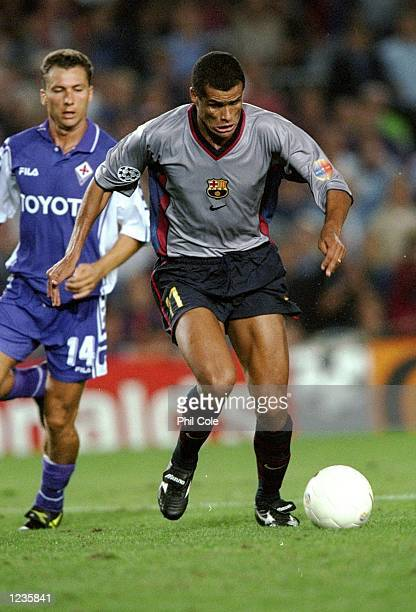 Rivaldo of Barcelona beats Sandro Cois of Fiorentina during the UEFA Champions League group B match at the Nou Camp in Barcelona Spain Barcelona won...