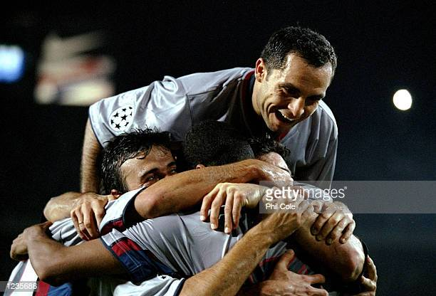 Rivaldo of Barcelona celebrates his goal against Fiorentina with team mates Luis Enrique and Sergi Barjuan during the UEFA Champions League group B...