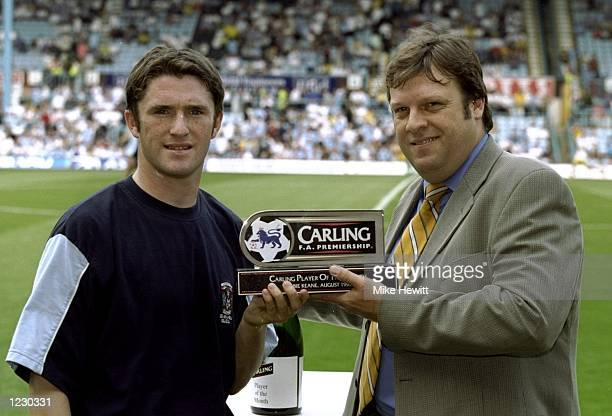 Robbie Keane of Coventry City receives the Player of the Month Award for August before the FA Carling Premiership match against Leeds United at...