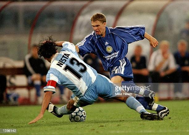 Serhii Rebrov of Dynamo Kiev is tackled by Alessandro Nesta of Lazio during the UEFA Champions League group A match at the Stadio Olimpico in Rome...