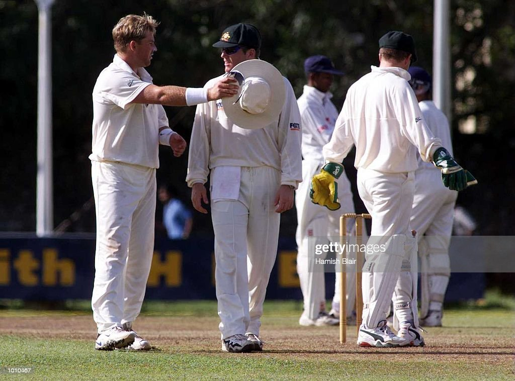 Shane Warne (left) and Stuart MacGill of Australia chat between overs, during day one of the tour match between the Sri Lanka Board XI and Australia at Saravanamuttu Stadium, Colombo, Sri Lanka. Mandatory Credit: Hamish Blair/ALLSPORT