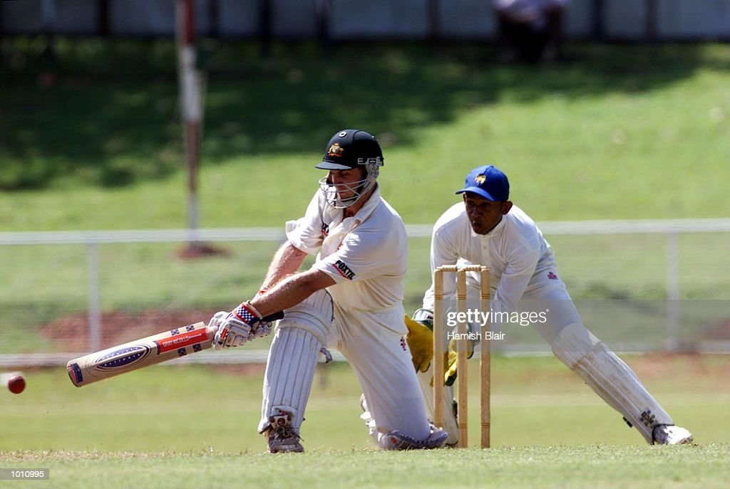 Simon Katich, making his first class debut for Australia, on the attack with Prasanna Jayawardene of the Board XI looking on, during day one of the Tour match between the Sri Lanka Board XI and Australia at Colombo Cricket Club, Colombo, Sri Lanka. Mandatory Credit: Hamish Blair/ALLSPORT