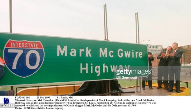 Sep 1999 St Louis MO Missouri Governor Mel Carnahan and St Louis Cardinals president Mark Lamping look at the new Mark McGwire Highway sign as it is...