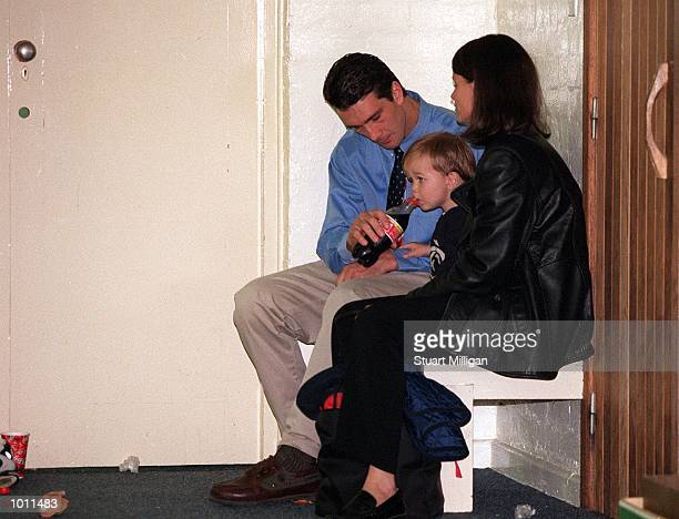 Stephen Silvagni for Carlton sits with wife Jo and son Jack in the rooms after Carlton's loos in the AFL Grand Final match between the Kangaroos and...