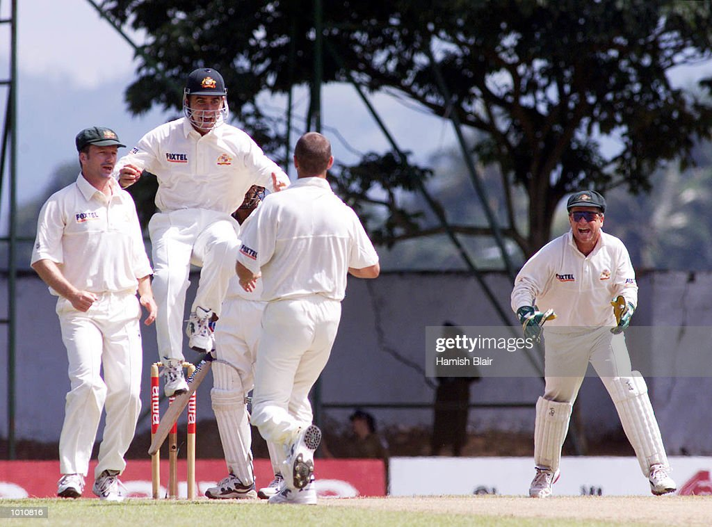 Steve Waugh (left), Justin Langer (in air) Colin Miller and Ian Healy of Australia, celebrate as Langer catches Maravan Attapatu of Sri Lanka, during day two of the First Test between Sri Lanka and Australia at Asgiriya Stadium, Kandy, SriLanka. Mandatory Credit: Hamish Blair/ALLSPORT