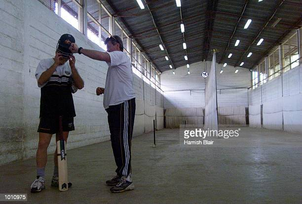 Steve Waugh of Australia removes his helmet with assistance from Physio Errol Allcot after his first bat since breaking his nose last week during...