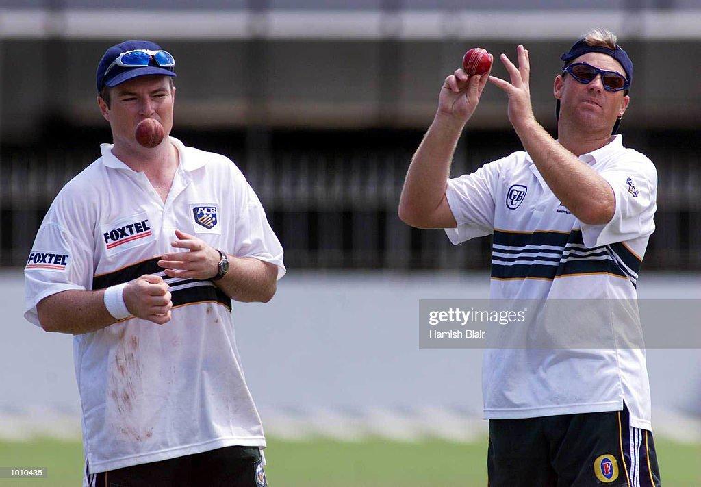 Stuart MacGill and Shane Warne look on, during Australian training at Singhalese Stadium, Colombo, Sri Lanka. Mandatory Credit: Hamish Blair/ALLSPORT