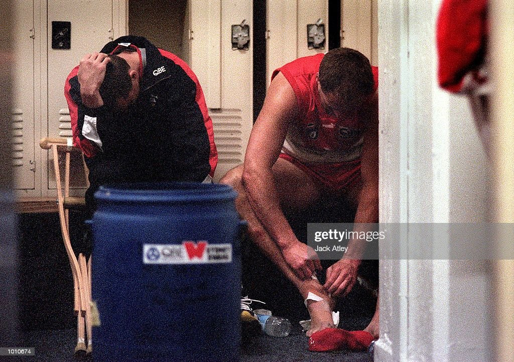 Sydney Swans captain Paul Kelly #14 (left) and Tony Lockett #4 for Sydney sit dejected in the dressing rooms after the fourth qualifying final played at the Melbourne Cricket Ground, Melbourne, Australia. Kelly badly damaged his knee duringthe match and Lockett, who is the all time leading goalkicker retired after the match. Essendon won the match easily. Mandatory Credit: Jack Atley/ALLSPORT