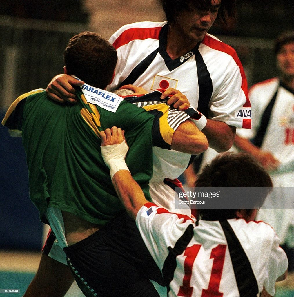T. Ramadani of Australia is tackled by N.Abe of Japan during the match between Australia v Japan at the Southern Cross International Handball Challenge, at the Buring Pavilion, Sydney Olympic Park Homebush, Sydney Australia. Mandatory Credit: Scott Barbour/ALLSPORT