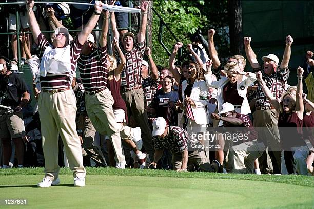 The American players and wives celebrate after Justin Leonard of the USA sinks a long birdie putt on the 17th green during the final day of the 33rd...