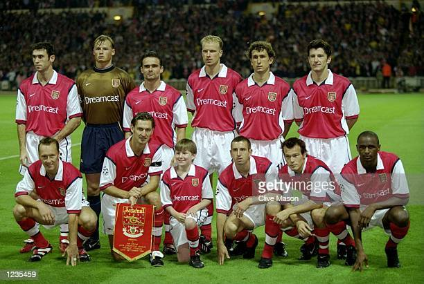 The Arsenal team line up prior to the UEFA Champions League match between Arsenal v AIK Solna played at Wembley Stadium London The game finished in a...