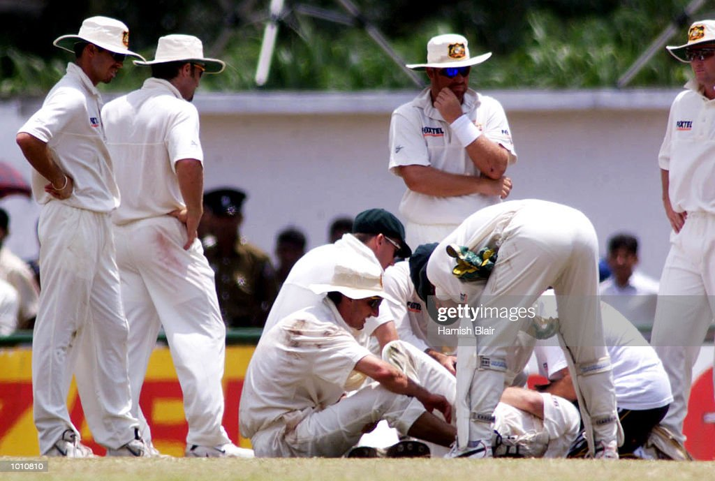 The Australian team crowd around after Jason Gillespie and Steve Waugh of Australia collided attempting a catch, during day two of the First Test between Sri Lanka and Australia at Asgiriya Stadium, Kandy, Sri Lanka. Mandatory Credit: Hamish Blair/ALLSPORT