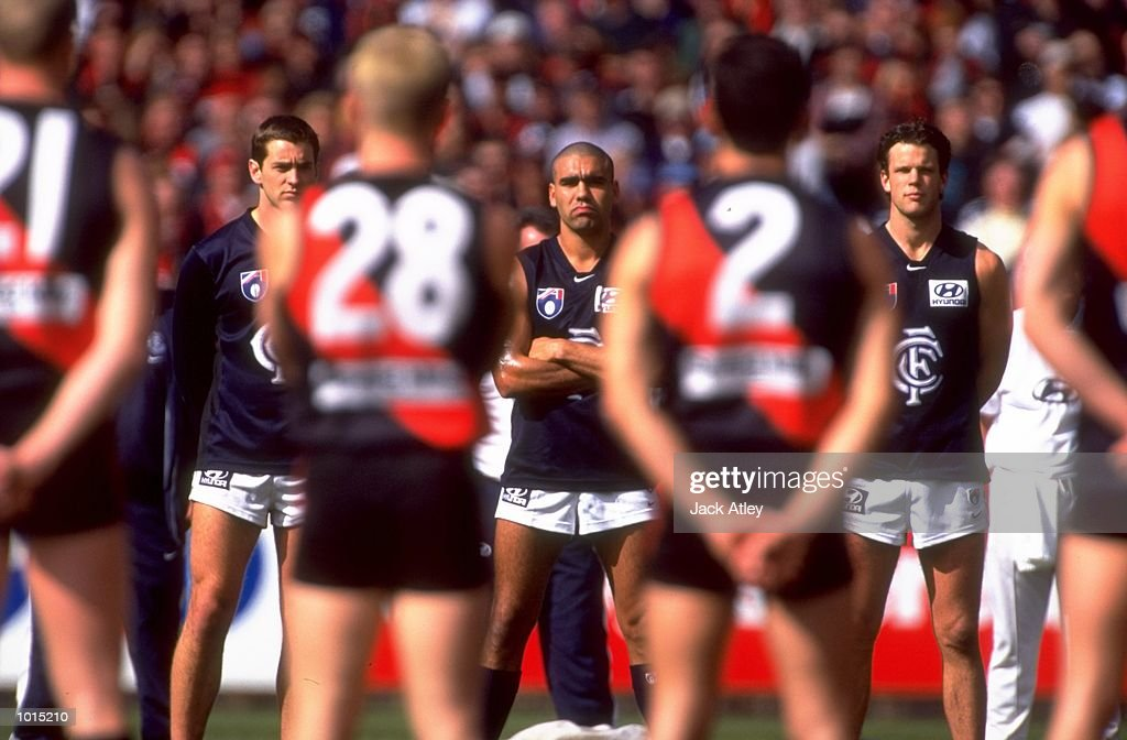 The Carlton Blues and Essendon Bombers players line up for the national anthem before the AFL Second Preliminary Final at the MCG in Melbourne, Australia. Carlton progressed to the Grand Final with a tense 104 - 103 win. \ Mandatory Credit:Jack Atley /Allsport