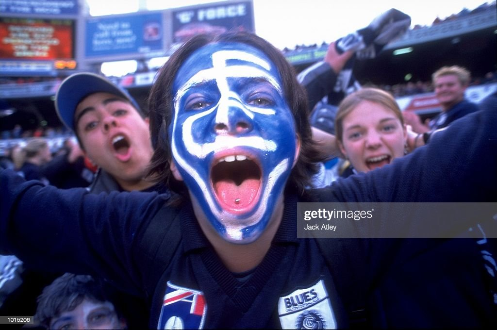 The Carlton Blues fans cheer on their team during the AFL Second Preliminary Final against the Essendon Bombers at the MCG in Melbourne, Australia. Carlton progressed to the Grand Final with a tense 104 - 103 win. \ Mandatory Credit: Jack Atley /Allsport