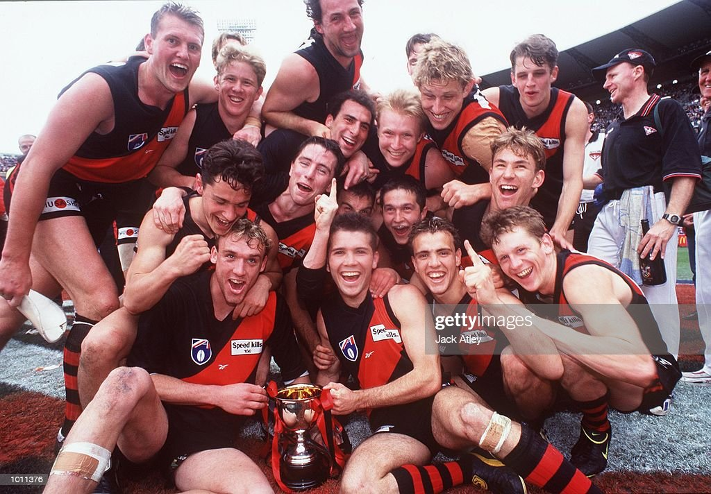 The Essendon team celebrates with the cup after their win, in the AFL Reserves Grand Final match between St Kilda and Essendon, played at the Melbourne Cricket Ground, Melbourne, Australia. Essendon defeated St Kilda. Mandatory Credit: JackAtley/ALLSPORT
