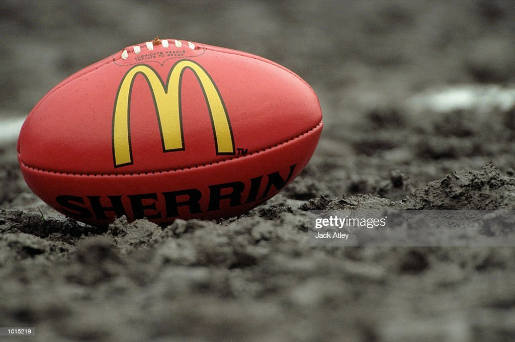 The matchball sits in the mud before the AFL Fourth Qualifying Final between the Sydney Swans and Essendon Bombers at the MCG in Melbourne, Australia. The Bombers progressed to the latter stages with a convincing 123 - 54 win. \ Mandatory Credit: Jack Atley /Allsport