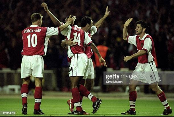 Thierry Henry of Arsenal celebrates with some team mates during the UEFA Champions League match between Arsenal v AIK Solna played at Wembley Stadium...