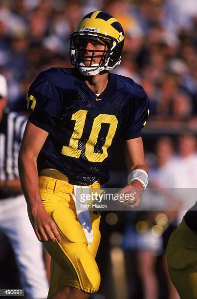 Tom Brady of the Michigan Wolverines looks to the sidelines during the game against the Notre Dame Fighting Irish at the Michagain Stadium in Ann...