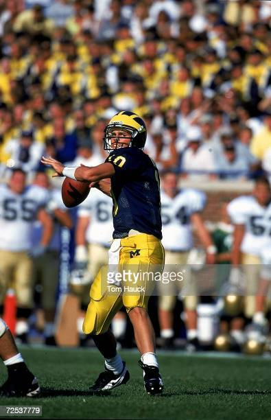 Tom Brady of the Michigan Wolverines passes the ball during the game against the Notre Dame Fighting Irish at the Michigan Stadium in Ann Arbor...
