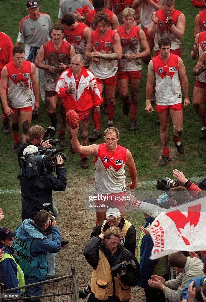 Tony Lockett #4 for the Sydney Swans leaves the arena following the fourth qualifying final played at the Melbourne Cricket Ground, Melbourne, Australia between Essendon and Sydney. Lockett, who is the A.F.L. all time leading goalkicker retired after the match. Essendon won the match easily. Mandatory Credit: Jack Atley/ALLSPORT
