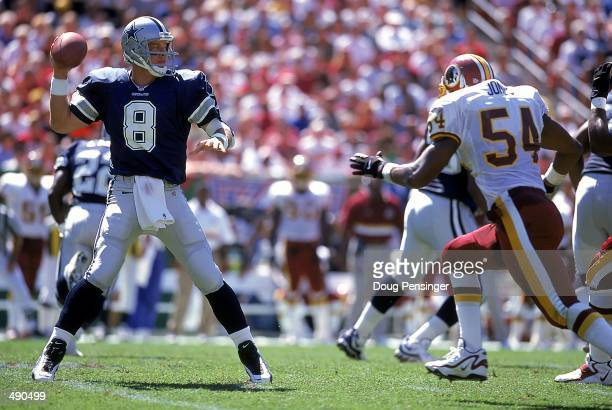 Troy Aikman of theDallas Cowboys steps back to pass the ball during the game against the Washington Redskins at the Redskins Stadium in Landover,...