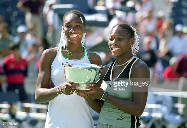 Venus and Serena Williams of the USA pose with their trophy after the doubles match against Chanda Rubin of the USA and Sandrine Testud of France in...