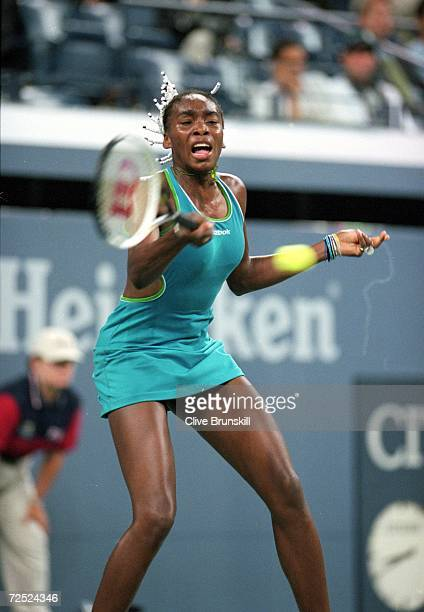 Venus Williams of the USA hits the ball during the match between Barbara Schett of Austria in the US Open day 8 at the USTA National Tennis Center in...