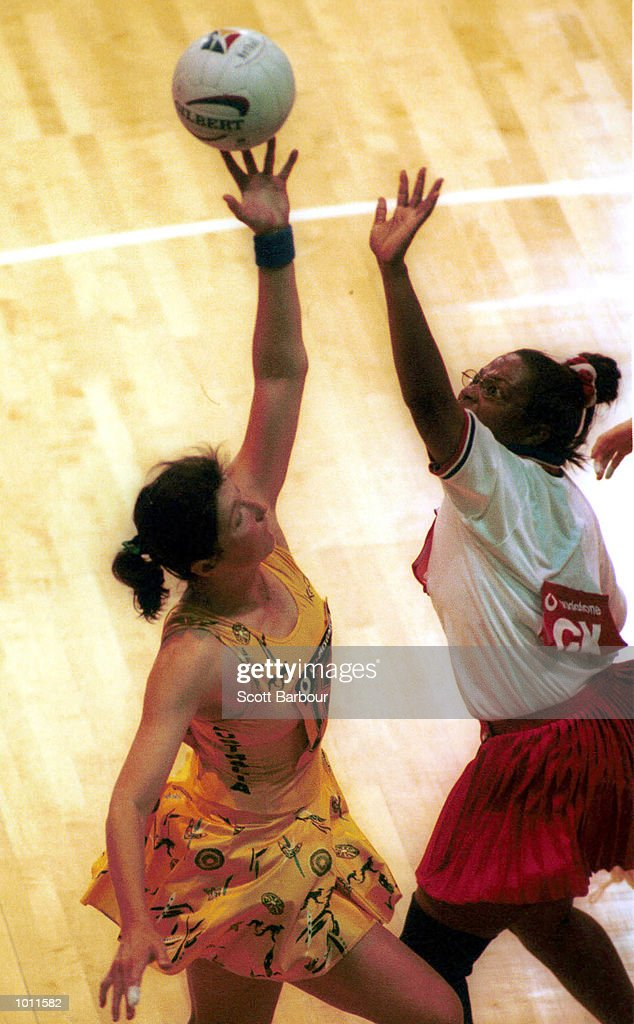 Vicki Wilson of Australia gains control of the ball with Venilda Wallace of the USA watching during the Australia v USA game in the 1999 World Netball Championships held at the WestPac Trust Stadium, Christchurch, New Zealand. Australia won92-27. Mandatory Credit: Scott Barbour/ALLSPORT
