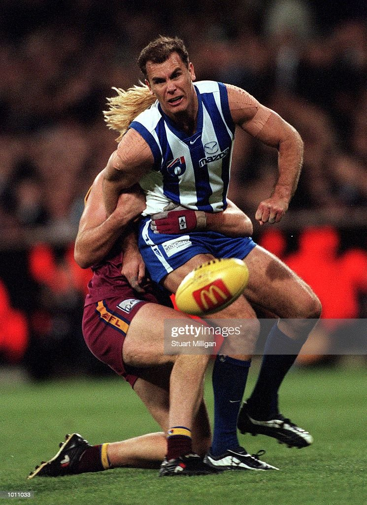 Wayne Carey #18 for the Kangaroos is caught by Adam Heuskes #31 for Brisbane, in the AFL First Preliminary Final match between the Kangaroos and the Brisbane Lions, played at the Melbourne Cricket Ground, Melbourne, Australia. Mandatory Credit: Stuart Milligan/ALLSPORT
