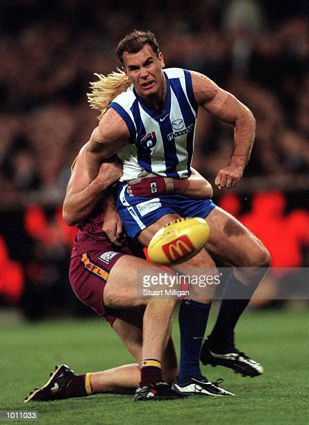 Wayne Carey for the Kangaroos is caught by Adam Heuskes for Brisbane in the AFL First Preliminary Final match between the Kangaroos and the Brisbane...