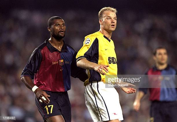 Winston Bogarde of Barcelona and Dennis Bergkamp of Arsenal in action during the Barcelona v Arsenal UEFA Champions League Group B match played at...