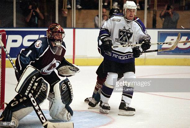 Ziggy Palffy of the Los Angeles Kings stands next to David Aebischer of the Colorado Avalanche at the Great Western Forum in Inglewood California The...