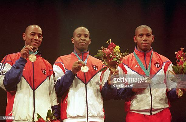A view of the Cuba Men's Fencing team showing off their Bronze Medals during the awards ceremony for the Men's Team Epee Finals for the 2000 Sydney...